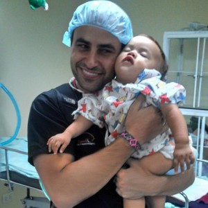 Dr. Talei with a baby patient