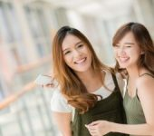 Two Smiling Asian Young Women