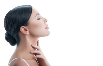 Woman Feeling Her Neck After Kybella Injections Beverly Hills CA
