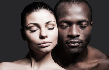 beautiful faces of a Caucasian woman and Afro-American man with perfect skin after Facial Procedures in Beverly Hills CA