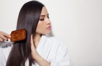 woman brushing her dark long hair