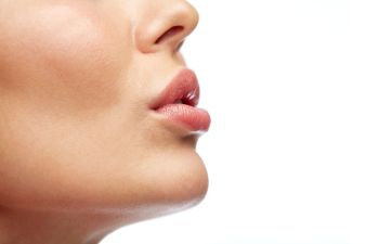 Ideally shaped full lips of a woman after Lip Procedures in Beverly Hills, CA.